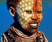 A Karo woman of southwest ethiopia spends hours perfecting her clay-ball hairstyle, pigment face-paint, and layers of glass and wild banana seed necklaces, all of which make her attractive to the opposite sex. Karo woman of southwest ethiopia spends hours perfecting her clay-ball hairstyle, pigment face-paint, and layers of glass and wild banana seed necklaces, all of which make her attractive to the opposite sex.