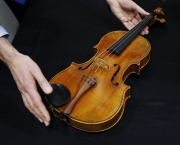 "A rare 1719 viola called the ""Macdonald"" by Antonio Stradivari is displayed during a preview at the Sotheby's auction in Hong Kong Friday, April 4, 2014. A rare 1719 Stradivarius viola is expected to sell for more than US$45 million in a private sale by Sotheby's. The auction house says that price would be a record for a musical instrument sold privately or at auction. (AP Photo/Kin Cheung)"